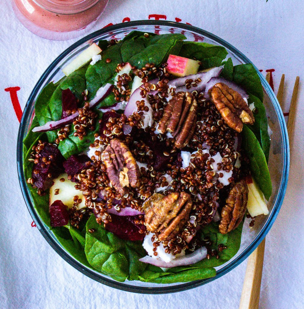 christmas salad with quinoa, beets, candied pecans and raspberry blush dressing