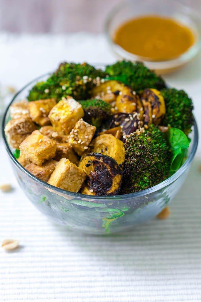 vegan grilled vegetable buddha bowl with miso peanut sauce